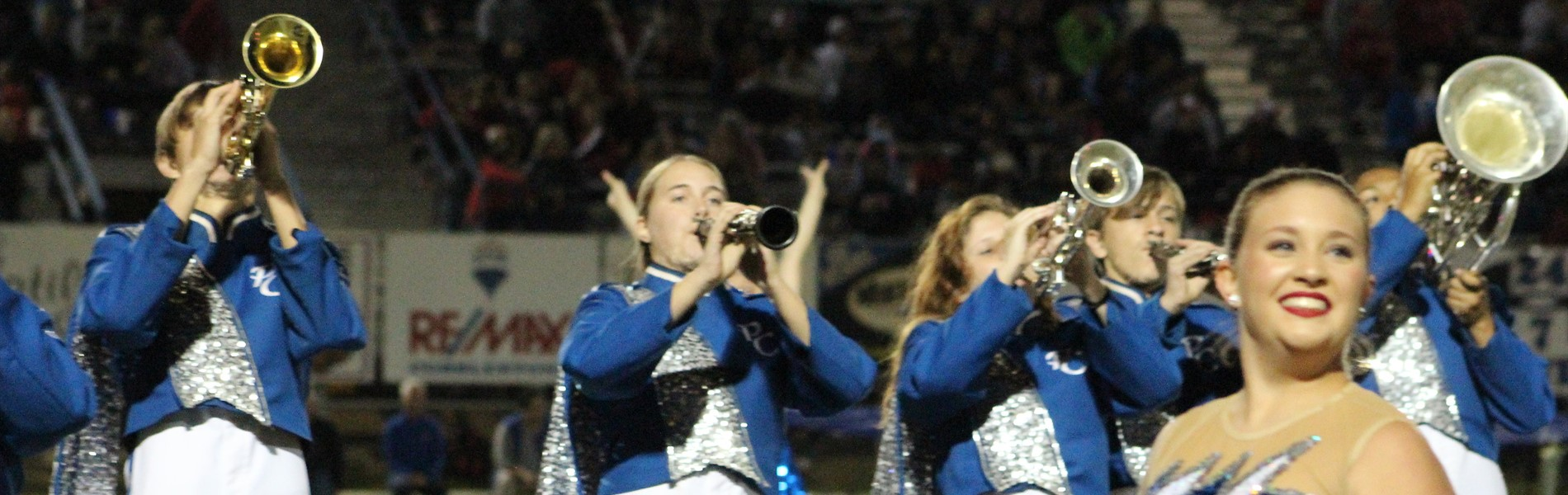 Band members performing during football half time show