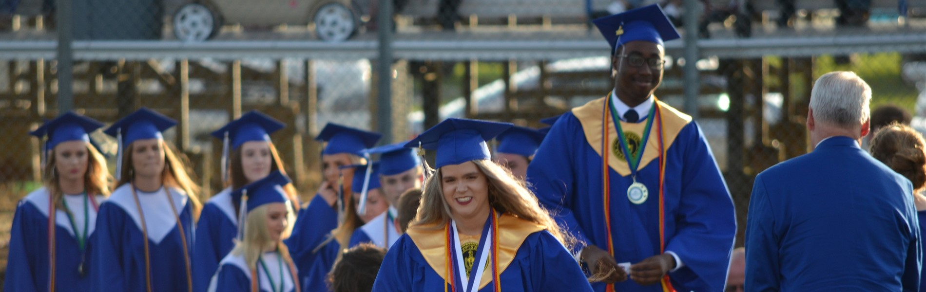Pierce County High School graduates walking across the stage and receiving a diploma.