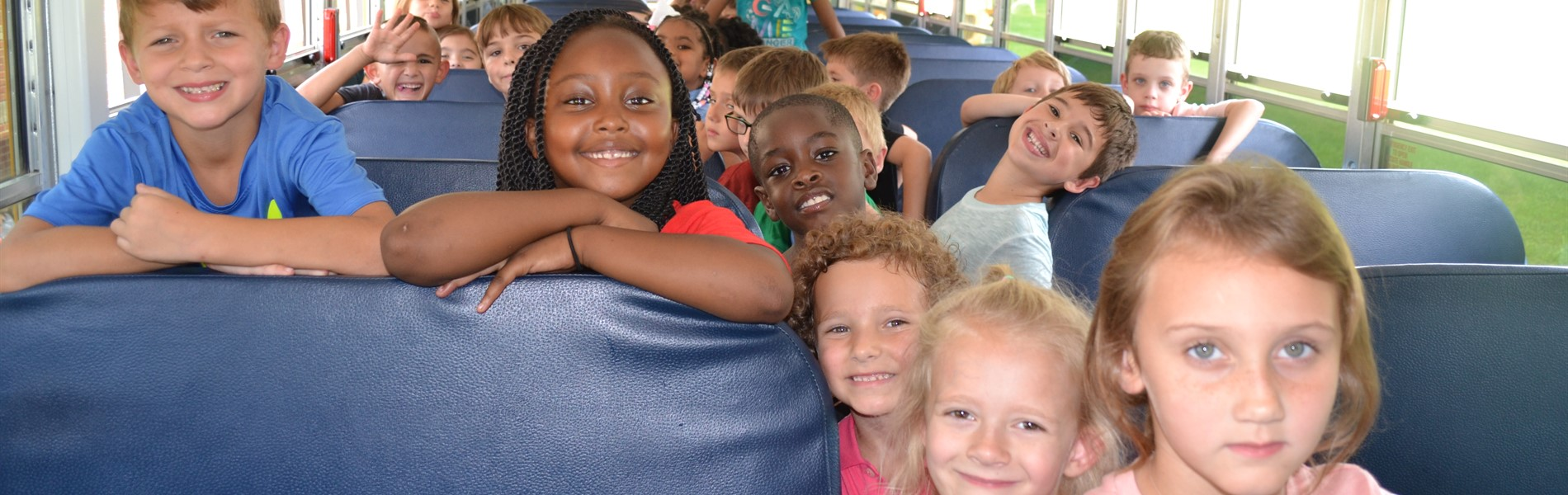 First graders practicing bus safety