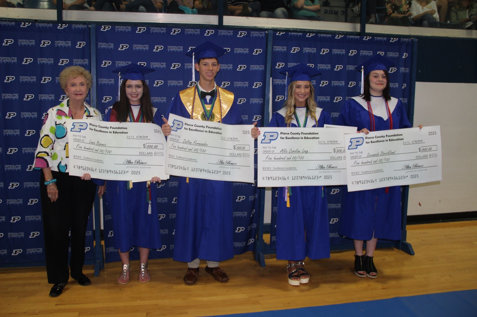 Foundation Chair Alta Bruce with students receiving scholarships